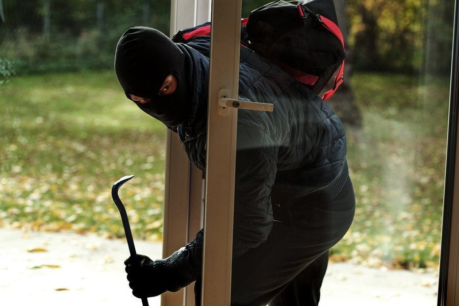 bigstock Burglar Entering To House 59237540 1 - Defend Your Home Against Burglaries and Home Invasions